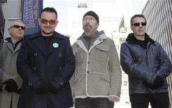 <p>Members of the rock group U2, Adam Clayton (L), Bono (2nd L), Edge (2nd R) and Larry Mullen (R), attend a ceremony where a portion of West 53rd Street was renamed U2 Way in New York, March 3, 2009. REUTERS/Gary Hershorn</p>