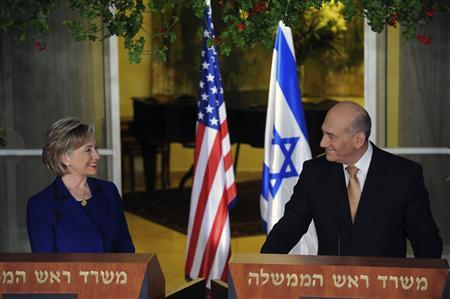 U.S. Secretary of State Hillary Clinton (L) and outgoing Israeli Prime Minister Ehud Olmert smile during a meeting in Jerusalem March 3, 2009, in this picture released by the Israeli Government Press Office (GPO). REUTERS/Avi Ohayon/GPO/Handout