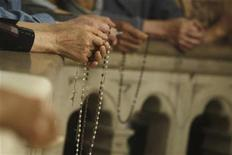 <p>Catholic faithful attend a mass during a pilgrimage in veneration of Virgin Mary at Sheshan Shrine in Shanghai, May 24, 2008. REUTERS/Aly Song</p>