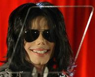 <p>Michael Jackson smiles during a news conference at the O2 Arena in London March 5, 2009. REUTERS/Stefan Wermuth</p>