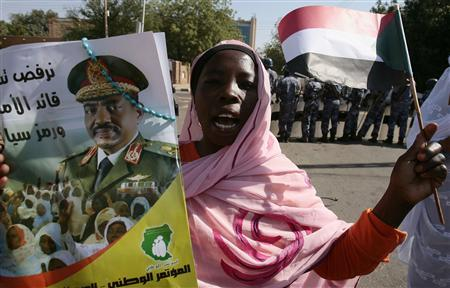 A woman supporting Sudan's President Omar Hassan al-Bashir chants slogan during a sit-in next to United Nations Development Programme (UNDP) headquarter in Khartoum March 6, 2009, against the International Criminal Court (ICC) for issuing an arrest warrant for Bashir. The poster reads, ''We will not give up the leader of our nation.'' REUTERS/Zohra Bensemra