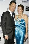 "<p>Actor Tom Hanks and his wife, actress Rita Wilson, laugh as they pose at Saks Fifth Avenue's ""Unforgettable Evening"" benefiting the Entertainment Industry Foundation's Women's Cancer Research Fund in Beverly Hills, California February 10, 2009. REUTERS/Danny Moloshok</p>"