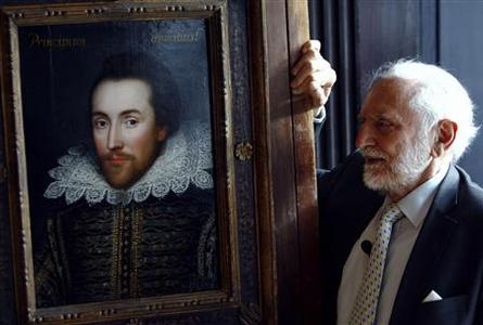 Chairman of The Shakespeare Birthplace Trust, Stanley Wells, poses for photographers with a newly discovered portrait of poet William Shakespeare at Dartmouth house in London March 9, 2009. A 300 year-old portrait of Shakespeare, believed to be the only authentic image of him painted while he was alive was unveiled on Monday. REUTERS/Luke MacGregor