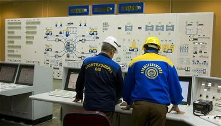 Russian technicians work in the control room at the nuclear power plant in Bushehr, 1200 km (746 miles) south of Tehran February 25, 2009. REUTERS/Caren Firouz
