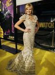 """<p>La actriz de la cinta """"Watchmen"""" Malin Akerman posa durante el estreno del filme en Hollywood, EEUU, 2 mar 2009. La película de superhéroes """"Watchmen"""" fue la más vista en Gran Bretaña durante el fin de semana, reemplazando a """"Slumdog Millionaire"""" en el primer lugar del ranking, señaló el martes Screen International. REUTERS/Mario Anzuoni</p>"""