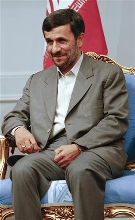 Iran's President Mahmoud Ahmadinejad attends a meeting with Turkey's President Abdullah Gul (not pictured) in Tehran March 10, 2009. REUTERS/Raheb Homavandi