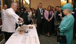 <p>Britain's Queen Elizabeth grimaces as chef Heston Blumenthal makes ice cream using liquid nitrogen during the launch of the Royal Institution of Great Britain in central London in this file photo from May 28, 2008. REUTERS/Luke MacGregor</p>