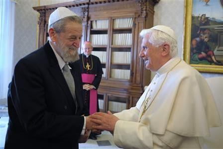 Pope Benedict XVI (R) greets Chief Rabbi of Haifa, Rabbi Shear Yashuv Cohen, during their meeting at the Vatican March 12, 2009. Israel's religious leaders asked the Pontiff on Thursday to make Holocaust studies a required subject in catholic schools, saying it could help stamp out potential anti-Semitism in future generations. REUTERS/Osservatore Romano