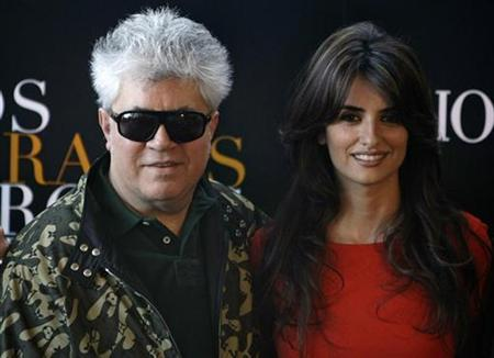 Spanish director Pedro Almodovar (L) poses with actress Penelope Cruz during a photocall for his new movie ''Los Abrazos Rotos'' (Broken Embraces) in Madrid, in this file photo from March 13, 2009. REUTERS/Sergio Perez