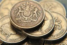 <p>A pile of one pound coins is seen, in central London June 17, 2008. REUTERS/Toby Melville</p>