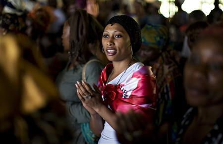 A woman sings during a prayer session at the Saint Francis Xavier parish, part of the fraternity Ephphata charismatic awakening branch of the Catholic church, ahead of the arrival on Tuesday of Pope Benedict XVI in Yaounde March 17, 2009. REUTERS/Finbarr O'Reilly