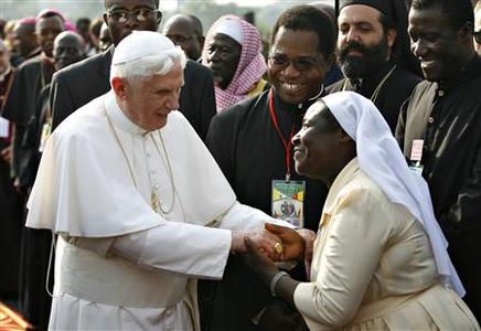 Pope Benedict XVI is greeted by a Cameroonian nun upon his arrival at the airport in Yaounde March 17, 2009. REUTERS/Finbarr O'Reilly