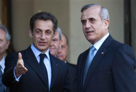 France's President Nicolas Sarkozy (L) accompanies Lebanon's President Michel Suleiman as he leaves the Elysee Palace in Paris March 16, 2009. REUTERS/Philippe Wojazer
