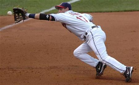 Cleveland Indians third baseman Aaron Boone grabs grounder hit by Melky Cabrera of the New York Yankess in the fourth inning of their American League game in Cleveland, Ohio, July 3, 2006. REUTERS/Ron Kuntz