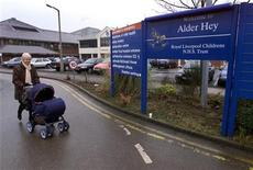 <p>A woman pushes a pram past the entrance to the Alder Hey hospital in Liverpool in this file photo from January 30, 2001. DC</p>