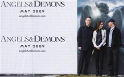 """<p>U.S. actor Tom Hanks, Israeli actress Ayelet Zurer and U.S. director Ron Howard (L-R) attend a photocall to promote the movie """"Angels & Demons"""", premiering May 15, at the European Organisation for Nuclear Research (CERN) in Meyrin near Geneva February 12, 2009. REUTERS/Valentin Flauraud</p>"""