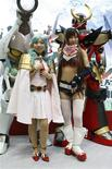 "<p>Booth assistants in costume from a Japanese animation ""Gurren Lagann"" pose at a photo opportunity at Tokyo International Anime Fair 2009 in Tokyo March March 20, 2009. REUTERS/Issei Kato</p>"