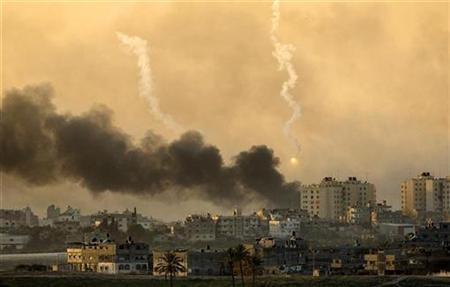Smoke rises and a weapons system fired by Israeli forces explodes above the northern Gaza Strip January 15, 2009. REUTERS/Jerry Lampen