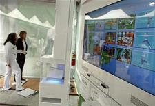 <p>People try Nintendo's new Wii Fit, a new interactive fitness game for Wii system during the product launch in New York May 19, 2008. REUTERS/Shannon Stapleton</p>