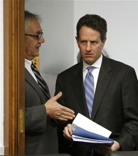 U.S. Treasury Secretary Timothy Geithner (R) talks with House Financial Services Committee Chairman Barney Frank before testifying in the committee's hearing on ''Oversight of the Federal Government's Intervention at American International Group (AIG)'' on Capitol Hill in Washington March 24, 2009. REUTERS/Kevin Lamarque