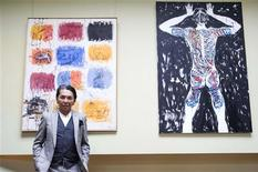 <p>Japanese designer Kenzo Takada, known as Kenzo, poses for the media in his loft after a news conference in Paris March 24, 2009. REUTERS/Gonzalo Fuentes</p>