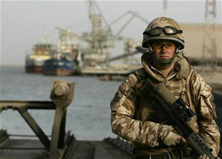 A British soldier stands guard at Umm Qasr port, in the southern the city of Basra, July 7, 2008. REUTERS/Atef Hassan