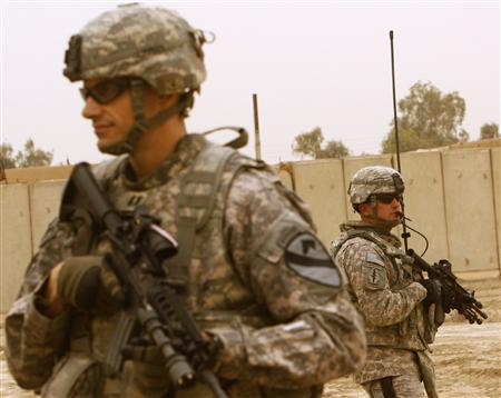 U.S. soldiers stand guard during a graduation ceremony of former neighbourhood patrol members, known locally as ''Sahwas'' from a training course in Baghdad's Jihad District, March 24, 2009. REUTERS/Bassim Shati