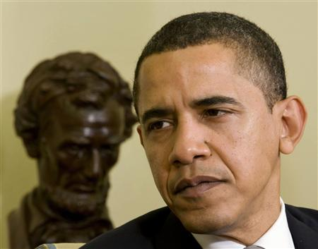 President Barack Obama listens to NATO Secretary-General Jaap de Hoop Scheffer in the Oval Office of the White House in Washington, March 25, 2009. REUTERS/Larry Downing