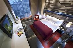 <p>An undated handout photo shows a room at Boutique hotel Quincy in Singapore. REUTERS/Handout</p>
