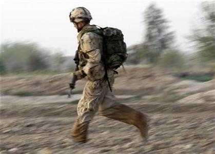 A NATO soldier runs for cover after an IED (Improvised Explosive Device) explosion during a mission in the Taliban stronghold of Zhari district in Kandahar province, southern Afghanistan, March 20, 2009. REUTERS/Stefano Rellandini
