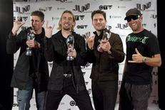 <p>Members of Nickelback pose with their three wards for Fan Choice, Album of the Year and Group of the Year during the Juno Awards in Vancouver, British Columbia March 29, 2009. Band members are (L-R) Daniel Adair, Chad Kroeger, Ryan Peake and Mike Kroeger. REUTERS/Richard Lam</p>