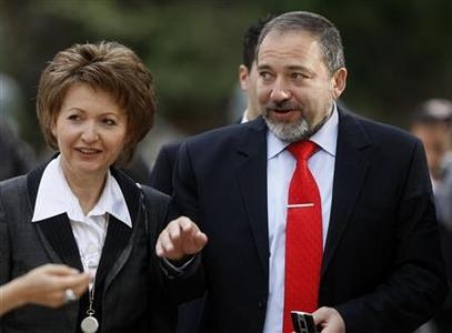 Incoming Israeli Foreign Minister Avigdor Lieberman (R) and his wife Ela attend the prime minister handover ceremony at the residence of President Shimon Peres in Jerusalem April 1, 2009. Peres told new Prime Minister Benjamin Netanyahu on Wednesday that the world backed the Palestinian quest for a state, a goal the incoming right-wing leader has not endorsed. Netanyahu was sworn in as Israeli prime minister on Tuesday after winning parliamentary approval for his right-leaning government. REUTERS/Menahem Kahana/Pool