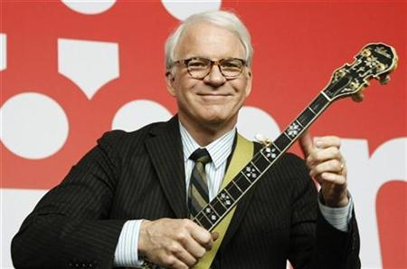 Actor Steve Martin plays a banjo during a press conference to promote the movie ''Pink Panther 2'' at the 59th Berlinale film festival in Berlin, February 13, 2009. REUTERS/Johannes Eisele
