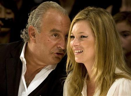 Super model Kate Moss and Top Shop owner Philip Green watch the Fashion for Relief charity fashion show in London September 20, 2007. REUTERS/Kevin Coombs