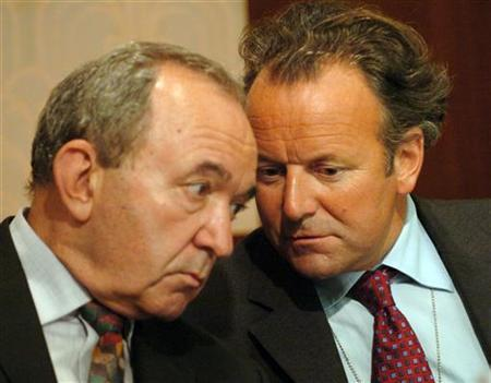 Committee members Justice Richard Goldstone (R), of South Africa, and Professor Mark Pieth (L), of Switzerland talk during a news conference held by the Independent Inquiry into the United Nations Oil for Food Program, August 9, 2004 in New York. REUTERS/Henny Ray Abrams HRA
