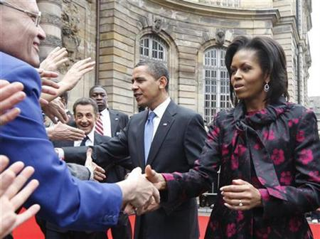 France's President Nicolas Sarkozy (2L-R), President Barack Obama and first lady Michelle Obama shake hands with people at Palais Rohan in Strasbourg April 3, 2009. REUTERS/Christian Hartmann