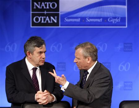 NATO Secretary General Jaap de Hoop Scheffer (R) talks to Prime Minister Gordon Brown during a cultural event at the Kurhaus in Baden-Baden, April 3, 2009. REUTERS/Yves Herman
