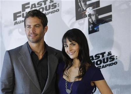 Actors Paul Walker (L) and Jordana Brewster pose during a photocall to promote ''Fast & Furious'' in Madrid March 25, 2009. REUTERS/Susana Vera