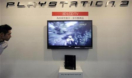 A man looks at a 3D LCD TV at the Sony Playstation booth during the Taipei Game Show 2009 in Taipei February 12, 2009. REUTERS/Pichi Chuang