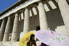 <p>Tourists stand in front of the Ifestus' temple at the archaeological site of Roman agora in Athens March 28, 2009. REUTERS/John Kolesidis</p>