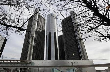 General Motors Corp World Headquarters is seen through tree branches in downtown Detroit, Michigan in this recent photo from April 2, 2009. REUTERS/Rebecca Cook