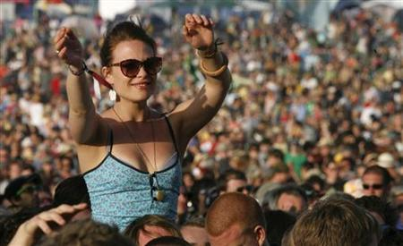 A fan enjoys a performance by French singer Manu Chao at the Glastonbury Festival 2008 in Somerset, southwest England, June 28, 2008. REUTERS/Luke MacGregor
