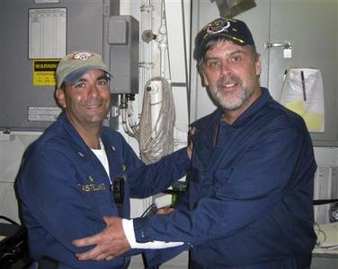 Maersk-Alabama captain Richard Phillips, (R), stands alongside Cmdr. Frank Castellano, the commanding officer of USS Bainbridge, after being rescued by U.S Naval Forces off the coast of Somalia, April 12, 2009. PREUTERS/Official U.S. Navy photo/Handout
