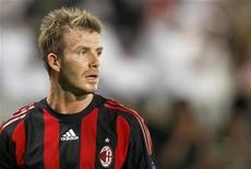 <p>AC Milan's David Beckham reacts against Al-Sadd during the Jafal Rashed testimonial soccer match at the Jassim Bin Hamed stadium in Doha March 4, 2009. REUTERS/Fadi Al-Assaad</p>