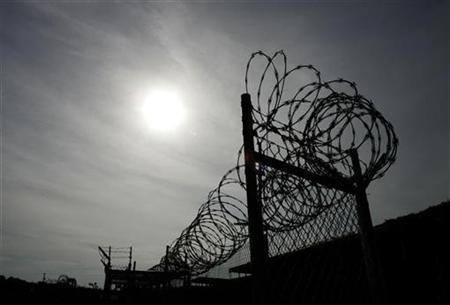 A rusting fence with barbed wire is shown at the unused Camp X-Ray at the Guantanamo Bay Naval Station in Guantanamo Bay, Cuba September 5, 2007. REUTERS/Joe Skipper