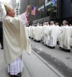 <p>New New York Archbishop Timothy Dolan greets a procession of catholic clergy outside St. Patrick's Cathedral before his Installation Mass in New York, April 15, 2009. REUTERS/Mike Segar</p>