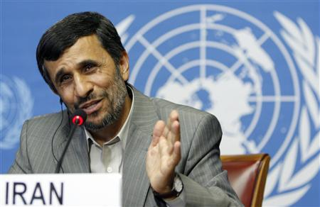 Iran's President Mahmoud Ahmadinejad gestures during a news conference after his address to the Durban Review Conference on racism at the United Nations European headquarters in Geneva April 20, 2009. United Nations officials sought on Monday to salvage a U.N. racism conference that Washington and its major allies are boycotting over concerns that it will be used as a platform for attacks against Israel. REUTERS/Denis Balibouse