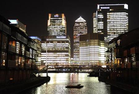 The Canary Wharf financial district is seen during mid-evening in East London March 26, 2009. REUTERS/Toby Melville