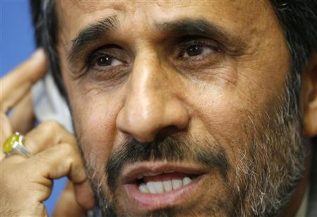 Iran's President Mahmoud Ahmadinejad gestures during a news conference after his address to the Durban Review Conference on racism at the United Nations European headquarters in Geneva April 20, 2009. REUTERS/Denis Balibouse