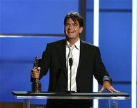 "<p>Actor Charlie Sheen accepts an award during the taping of the 2008 ""NCLR Alma"" awards at the Civic Auditorium in Pasadena, California August 17, 2008. REUTERS/Mario Anzuoni</p>"
